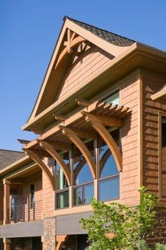 Exterior corbel truss design for an a frame roof line for Window trellis design