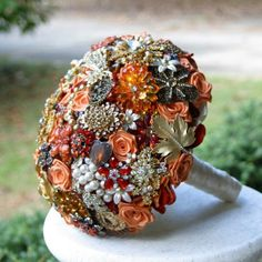 Vintage jewelry bouquet, I normally like blues and purples more, but this one really strikes me as beautiful.
