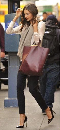 Miranda Kerr with Celine tote bag and cigarette pants