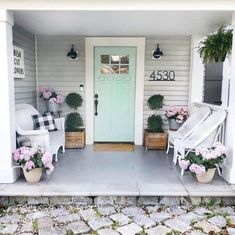 Gorgeous front porch with pastel seafoam door and white wicker chairs ont h Home, House With Porch, House Exterior, Porch Decorating, Exterior House Colors, White Wicker Chair, Modern House Number, Farmhouse Front, Front Door Decor