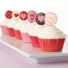 Candy Medallion Valentine Cupcakes - Easy candy circles create so many ways to express what's in your heart! Use Candy Melts candy to mold and decorate these enticing cupcake toppers.