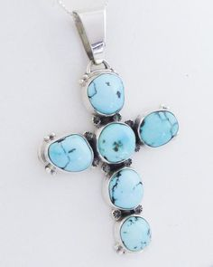 Sterling silver beads or rain drops and star imprints embellish this Cross pendant.