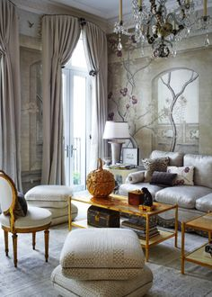 Papachristidis borrowed the silver, white, gold and plum color scheme for the Kips Bay space from two other projects he'd recently completed. The pair of Tony Victoria coffee tables have as their tops panels by artist Nancy Lorenz, and the 18th-century Georgian chandelier, from Gerald Bland, is strung with modern beads by ceramicist Eve Kaplan. Photo by Phillip Ennis