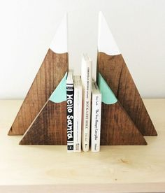 Style meets functionality in this adorable set of stained mountain inspired wooden bookends! These would make the perfect addition to any childs woodland, explorer, or whimsical bedroom, playroom or nursery! These are solid wood stained with white painted Woodworking For Kids, Popular Woodworking, Woodworking Projects Diy, Diy Wood Projects, Woodworking Plans, Wood Crafts, Woodworking Furniture, Woodworking Classes, Woodworking Shop