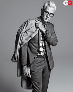 GQ Magazine April 2012 cover of John Slattery. Suit, $3,500 by Dior Homme. Shirt, $220 by Seize sur Vingt. Coat by Penfield. Belt by Martin Dingman. Watch by Cartier. Glasses by Ray-Ban. $3720  Photographed by Sebastian Kim