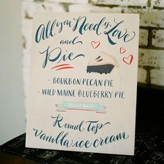 All you need is #love and #pie! #weddingsign #dessert   Photography: @sarahanneder   Pie: Two Fat Cats Bakery   Signage: Paper Tangent   Wedding Planning, Styling & Design: @emilyelizabethevents