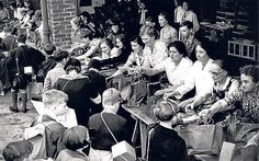 Dont waste it: food rations are handed to children evacuated from London on arrival at Amersham, Buckinghamshire