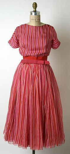 Cocktail dress James Galanos (American, born Philadelphia, Pennsylvania, 1924)  Date:     1954 Culture:     American Rounded Shoulder, Nipped in waist