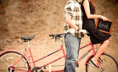 Engagements with a tandem bike!? LOVE this.