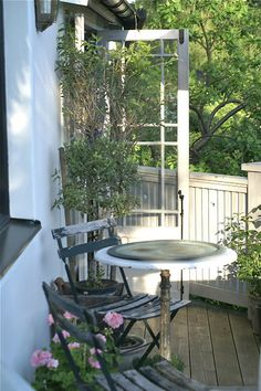 small bistro table and chairs...the simple life in the outdoors...cottage style