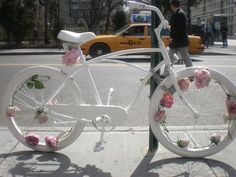 A white bicycle with flowers