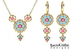 Jewelry Set: Necklace and Earrings by Lucia Costin with Pink and Light Blue Swarovski Crystals, Adorned with Lace Pattern, Cute Flowers and Fancy Charms; 14K Yellow Gold Plated over .925 Sterling Silver; Handmade in USA Lucia Costin. $129.00. Dangle ornaments accented with floral design; Lucia Costin floral set of jewelry; Adorned with rose and aquamarine Swarovski crystals; Style takes wings in this lovely jewelry set that have a graceful flower shape; Handmade...