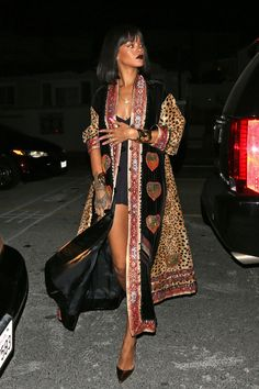 Rihanna night out in a printed kaftan, black romper, gold jewelry and pumps 1