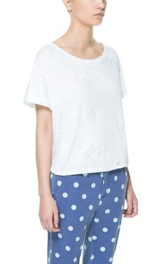 Image 1 of T-SHIRT WITH KNOT DESIGN AT THE FRONT from Zara
