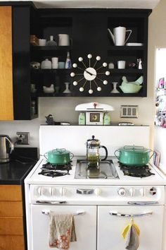 Vintage finds in minty shades add pop to a retro kitchen. Love those Kobenstyle pots!