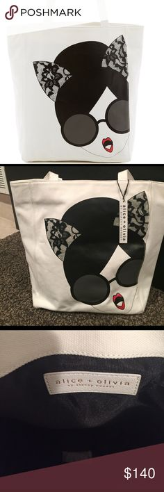 """Alice + Olivia canvas Stacey cat Tote Brand New with tags Alice and Olivia Stacey dons trendy lace cat ears in a cute print across durable canvas on this versatile tote. - Dual top handles - Open top - Exterior features print detail - Approx. 13.75"""" H x 11.25"""" W x 5"""" D - Approx. 10"""" handle drop Alice + Olivia Bags Totes"""