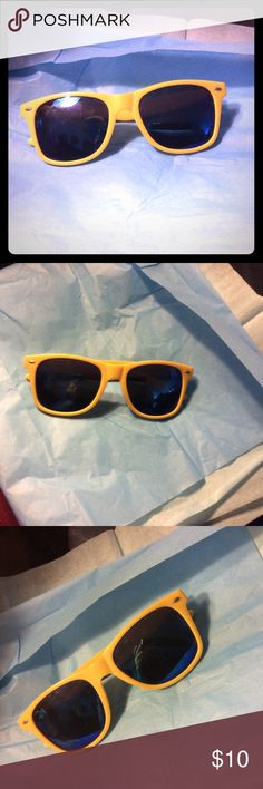 Yellow and blue sunnies Yellow framed sunglasses with blue lenses. Perfect condition Express Accessories Sunglasses