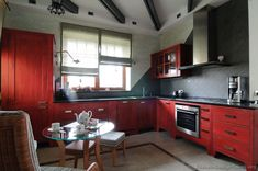 distressed red kitchen- my chioce over the modern, sparkly ones..