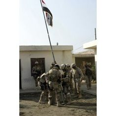 Soldiers from the Iraqi Special Forces raise the Iraqi National Flag in front of the office of the mayor of Fallujah Canvas Art - Stocktrek Images (23 x 34)