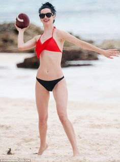 Having a ball: The former star of Don't Trust the B---- in Apartment 23 wore a bright red bikini top during a winter break in Quintana Roo i...