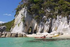 Picture of Photo of kayakers along the shores of Abel Tasman National Park on the South Island of New Zealand at Arch Point.