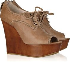 Miu Miu Leather Oxford wedges  2 165 PLN   Miu Miu taupe Oxford wedges. Mottled toffee heel measures approximately 125mm/ 5 inches with a 40mm/ 1.5 inch platform. Leather. Topstitch detail, lace-up front, almond peep toe. Zip fastening at back.