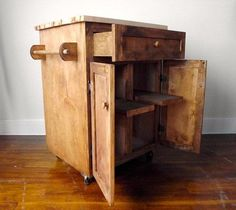 This kitchen cart with maple butcher block top is gorgeous.