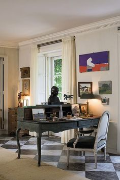 One of Bunny Mellon's desk.  Utterly unpretensious, family items gathered...things of mixed value, but all totally personal.