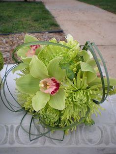 Orchid, chrysanthemum, and bear grass bouquet.