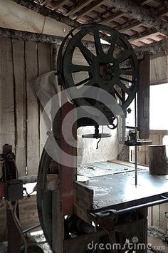 Photo about Woodworking workshop, detail of bandsaw cutting lumber in shadow. Image of vintage, machine, industrial - 135974085 Woodworking Bandsaw, Learn Woodworking, Woodworking Workshop, Shadow Photos, Diy And Crafts, Stock Photos, Detail, Image, Photography