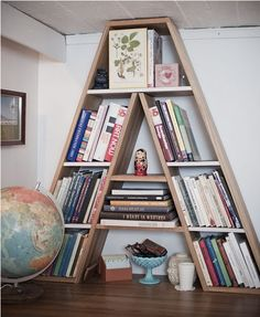 The COOLEST bookshelf! (Not sure where I'd put it, but cool nonetheless....)
