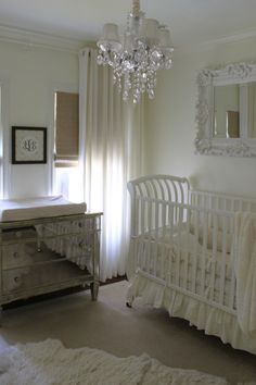 Acrylic curtain rods eliminate the horizontal line from stopping the eye, and allow the drapes to stand alone and soften this white-on-white space.