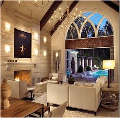 Big chandeliers really help to balance a room with a high ceiling.