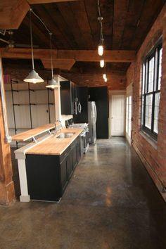 Lofts at Brister Mill Third floor Brick apartment kitchen - Soft opening