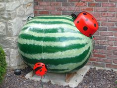 Came across this while searching for ideas to hide my ugly propane tank! How cute is that?!