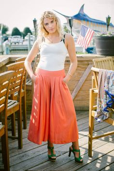 These awesome culotte pants are cool for a reason... they fit and flare kind of like a skirt and don't cling to any unflattering bits. These rust color ones are