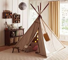 This would be so easy and inexpensive to make. Dowel rods, one or two painters drop cloths and hem it with no-sew ironing tape.    Tepee | Pottery Barn Kids