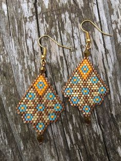 These beaded earrings have been handmade using size 11 delica beads, bicone beads and gold/silver plated earring wires. Please see my other listings for other colours. These particular earrings are approximately 5cm x 3cm.