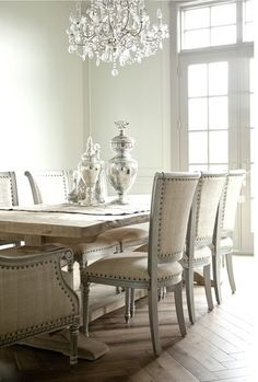 The chic of all chic! Studded dining chairs, with the studs and linen. The washed wood dining table looks stunning to boot. ~Sarah love the linen and the nailheads! I might have done silver nails, but that's just me...