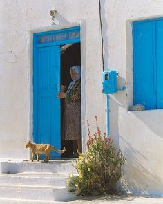 From my archives, May On a hot afternoon, an old lady lets her cat out of the front door. Scanned from negative in Go Greek, In Ancient Times, Greece Travel, Crete, Beautiful Islands, Athens, Art Reference, Facade, Travel Photography
