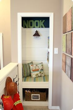 A small closet converted into a cozy little reading nook–cool idea!