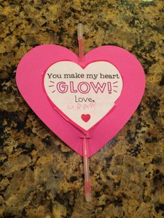 """You Make My Heart Glow"" - perfect Valentine's craft for 4yo. Cutting, gluing, writing name, inserting glowstick. Printable from: http://theteacherwife.blogspot.com/2011/12/you-make-my-glow-v-day-freebie.html"