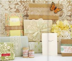 Brown paper packages tied up with strings.......lace......ribbon.....it's all cute! Okay, so they aren't all brown, but couldn't get that song out of my head while looking at them!