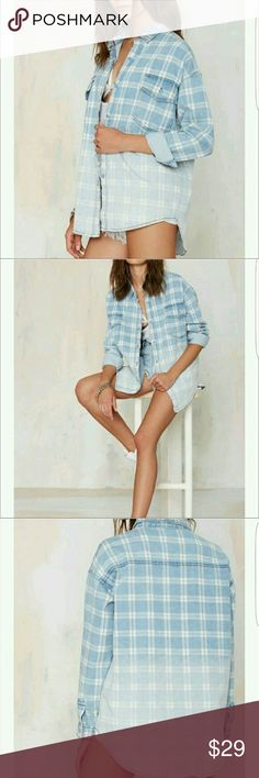 Nasty Gal So Faded Ombre Denim Button-Up Fade to cool. The So Faded Shirt is made in blue and white denim and features ombr? design and pockets at front. Pair it with skinnies, sneakers, and tousled hair.*Cotton  *Runs true to size  *Model is wearing size small  *Hand wash cold  *Imported Nasty Gal Tops