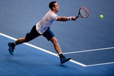 Andy Murray hits a forehand during his first round win over Go Soeda on Day 2 of Australian Open 2014.  - Ben Solomon/Tennis Australia