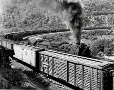 In position for a shot of Pennsylvania Railroad J1 2-10-4 No. 6427 climbing Horseshoe Curve with empty hopper cars in September 1955,