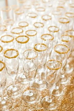 Love the sparkly gold addition to the rim of these champagne glasses. This shimmering and sugary detail will add a festive and fabulous touch to the party.