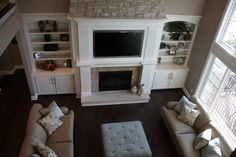 TV above fireplace and i love the shelves