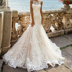Lace wedding dresses like this one can be expensive. But we can make close #replicas of designer dresses for less at www.dariuscordell.com