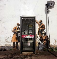 New Banksy Mural Depicts Government Agents Spying on a Phone Booth   Junkculture